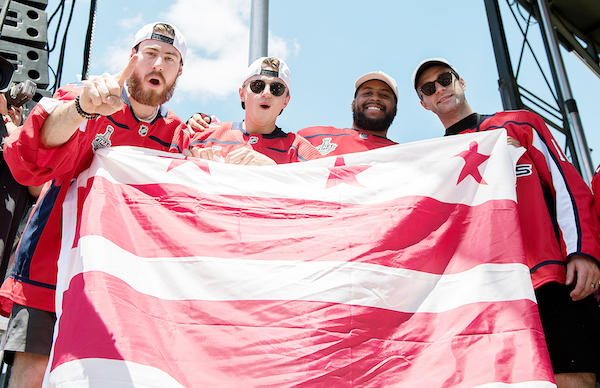 From left: Washington Capitals players Philipp Grubauer, Jakub Vrana, Devante Smith-Pelly and Brett Connolly celebrate with fans during the Stanley Cup championship parade on the National Mall in D.C. on June 12. (Khalid Naji-Allah)