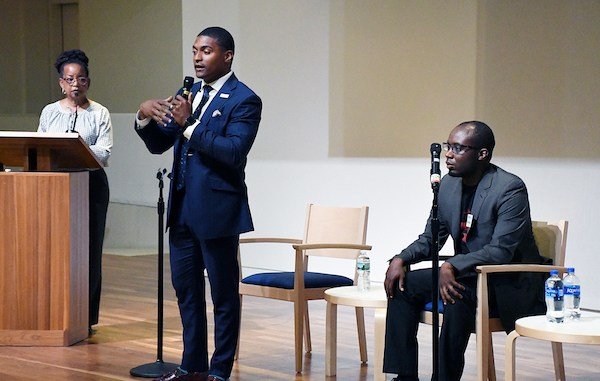 Marcus Goodwin (center) and Jeremiah Lowery (right), candidates for an at-large seat on the D.C. Council at a candidate.'s forum hosted by the ACLU and moderated by Denise Rolark Barnes (left), publisher of The Washington Informer, at the First Church of Christ in Northwest on May 30. (Roy Lewis/The Washington Informer)