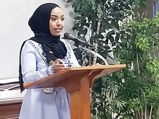 Hanan Sied gives a spoken-word performance during a faith-based celebration in support of area Muslims at the Lutheran Church of the Reformation in Northeast on June 5. (Jacqueline Fuller/The Washington Informer)