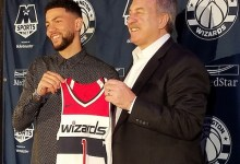 Washington Wizards guard Austin Rivers (left) and team President Ernie Grunfeld hold up Rivers' jersey during a July 2 press conference at Capital One Arena in D.C. to announce Rivers' arrival via trade. (William J. Ford/The Washington Informer)