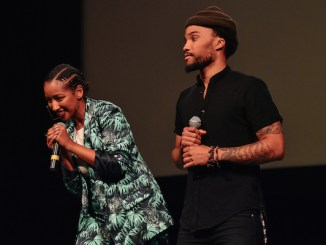 "Mignotae Kedebe (left) and Mansa Johnson acknowledge the audience at the ""What Happened 2 Chocolate City"" screening at the Lincoln Theatre in D.C. on June 21. (Photo courtesy of Shaughn Cooper)"