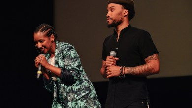 """Mignotae Kedebe (left) and Mansa Johnson acknowledge the audience at the """"What Happened 2 Chocolate City"""" screening at the Lincoln Theatre in D.C. on June 21. (Photo courtesy of Shaughn Cooper)"""