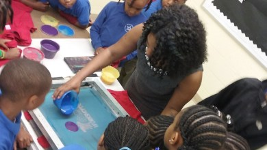 YEI founder Tachara Crump works with KidBiz participants. (Courtesy of YEI)
