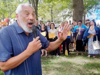Rev. Grayland Hagler speaks during the Interfaith Public Action rally at Lafayette Square on July 31. (Tahil Sharma)
