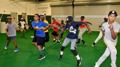 "After the Mamie ""Peanut"" Johnson Little League baseball team won the D.C. Little League Championship on July 24, the team practices at the Nationals Baseball Academy on July 30. According to the Little League schedule, the team advanced to the regional tournament in Bristol, Connecticut, which begins Aug. 5. (Robert R. Roberts/The Washington Informer)"