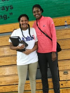 Semaj Williams (left) poses for a photo with Washington Mystics forward LaToya Sanders during a Jr. WNBA basketball clinic at Charles Hart Middle School in southeast D.C. on Sept. 11. (William J. Ford/The Washington Informer)