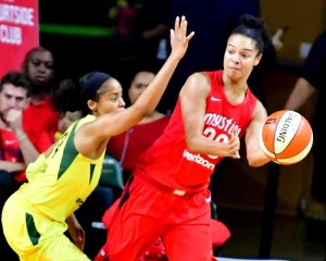 Washington Mystics point guard Kristi Toliver makes a pass around Seattle Storm guard Jewell Lloyd during the Storm's 98-82 win in Game 3 of WNBA Finals at Eagle Bank Arena at George Mason University on Sept. 12. (John De Freitas/The Washington Informer)