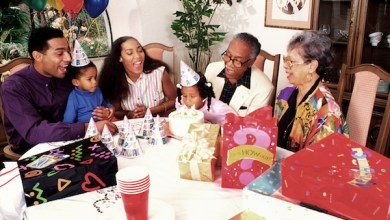 **FILE** A family celebrates the birthday of a child. (Photo by Education Images/UIG via Getty Images)