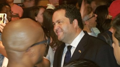Maryland Democratic gubernatorial nominee Ben Jealous takes selfies with supporters at the Cornerstone Grill and Loft in College Park during an Oct. 10 campaign rally. (William J. Ford/The Washington Informer)