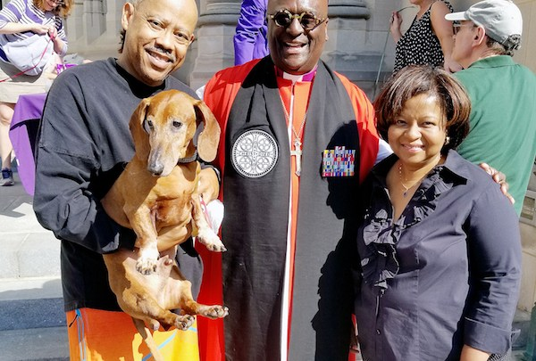 Bishop Carl Wright with Virgil and Rosalind Young and their pet Cousteau after receiving a blessing at the National Cathedral (Jacqueline Fuller/The Washington Informer)