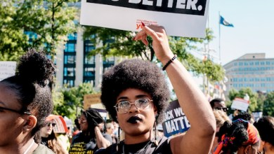5 A woman holds a sign while marching to Freedom Plaza during the 2nd annual March for Black Women in Washington, D.C on Saturday, Sept. 29. (Michael A. McCoy/The Washington Informer)