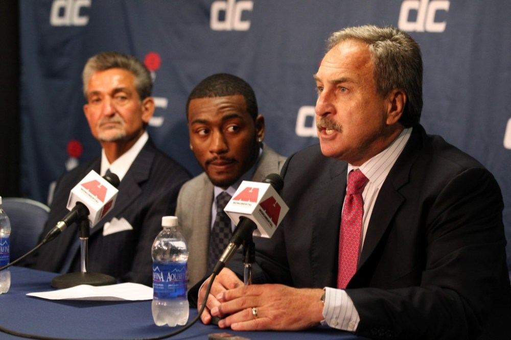 Wizards owner Ted Leonsis, left, All-Star point guard John Wall, center, join Ernie Grunfeld, right, at a press conference.