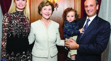 Rima Al-Sabah, Laura Bush, and Salem Al-Sabah holding baby Nasser 'Nino' Al-Sabah