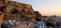 The Mehrangarh Fort rises above the blue city of Jodphur in the state of Rajasthan, India. Founded in 1459, its seven palaces have comprised the seat of the principality of Jodphur for more than 500 years.