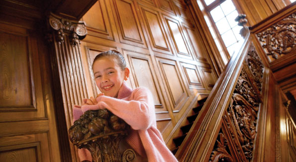 Valentina Pastrana home from her ballet class at The Washington Ballet on the staircase of the residence.