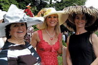 "Jane Sloat Ritchie, Christine Reed, and Victoria Lombardo, winner of the ""Show Stopper"" category of the Hat Contest at the 20th ""Perennial"" Garden Party at Woodrow Wilson House."