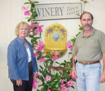 Holli and John Todhunter of Three Fox Vineyards, where membership in their Vintners Circle grants you harvesting privileges.