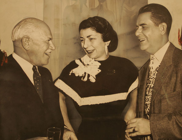 Gwen Cafritz greets Guatemalan Ambassador John Peurifoy and former Ambassador to Portugal Robert Guggenheim at her annual fall party marking the opening of the Supreme Court session. (Star Collection, D.C. Public Library; © Washington Post)