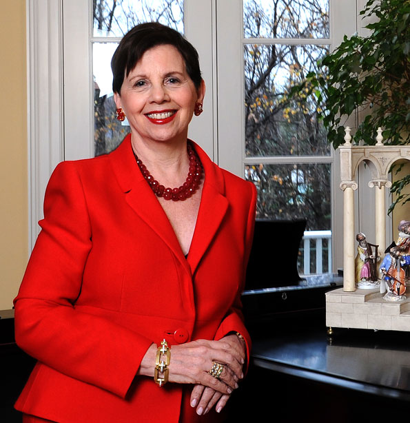 Adrienne Arsht poses near a collection of porcelain figurines in her new home. (Photo by Joseph Allen)