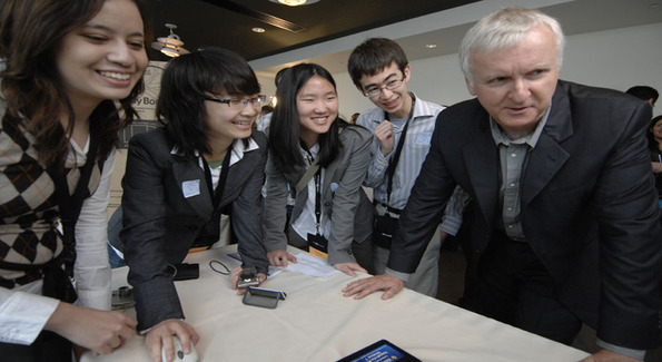 Christina Fries, Tianlu Zhang, Christina Chang and Cameron Solomon of Team Fortran C from UCLA show their game to James Cameron