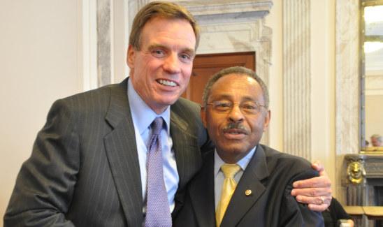 Senator Mark Warner congratulates Senator Roland Burris on his 73rd birthday.