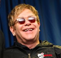 "Elton urged the politicians up the road on Capitol Hill to ""put away their swords"" and work together, ""like they do in England."""