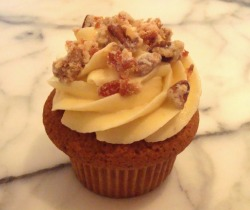 Hello Cupcake's Maple Brown Pecan cupcake is sprinkled in candied pecans and bacon.