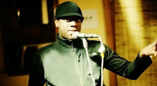 Ora Nwabueza on the mic; Photo courtesy: of Ora Nwabueze