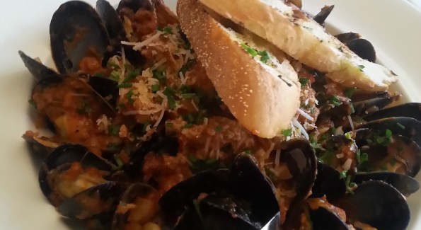 Order the Black Mussels with Hot Italian Sausage at Trevi 5, and sop up the spicy sauce with grilled bread. Photo courtesy of Kelly Magyarics.