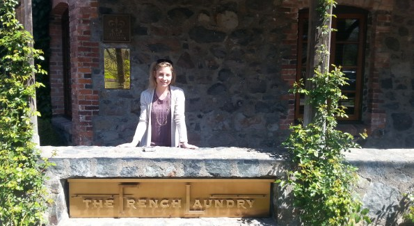 The author poses in front of the famed restaurant The French Laundry after a tour of Chef Thomas Keller's culinary garden. Photo courtesy of Kelly Magyarics.