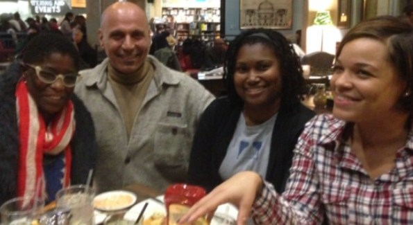 """""""Andy Shallal at the new Busboys and Poets in Brookland near Catholic University with school teachers Stacie Lampkins, Apryle Johnson, and Elizabeth Baird Thompson. (Photo by Adoria Doucette)"""