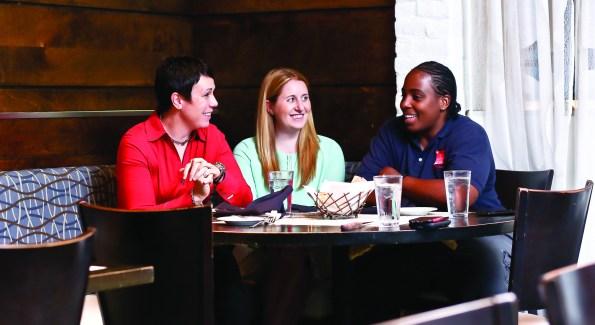 Allyson Hamlin, Laura Wainman and Trigger McNair talk football over lunch at Mio. (Photo by Tony Powell)