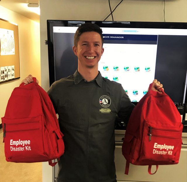 WSC member Nathaniel holding two emergency kits