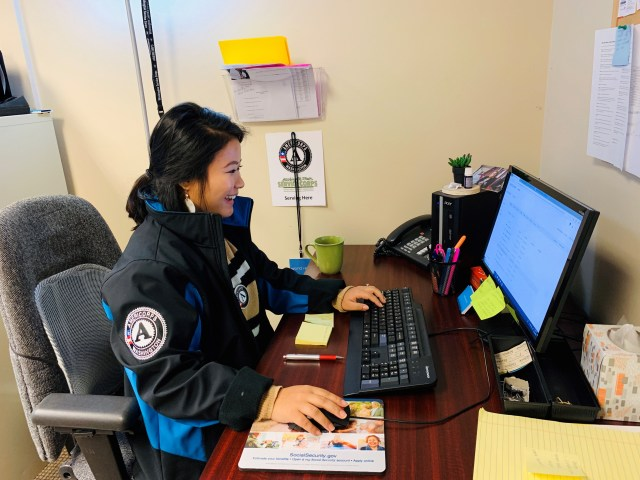 WSC member Mamata serving with World Relief Seattle, working at their desk