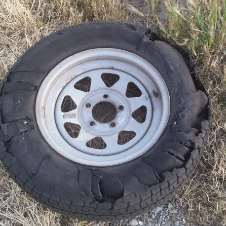 The first one, of two, blown trailer tires on the trip.