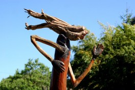 Old recycled wood is used to make a sculpture of a moving figure