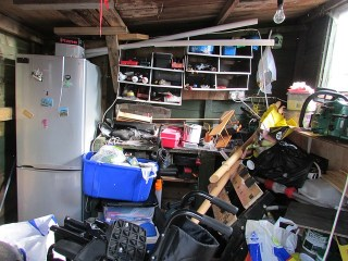 A bad case of garage clutter best removed by a garage rubbish clearance contractor.