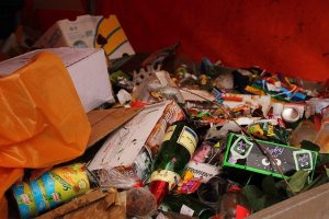 Image shows Typical festival waste lying around a bin. No Zero Waste here!