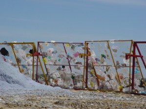 Litter Fence on a windy day. The landfill may need to close or reduce the hours of operation on windy days.