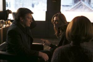 "CASTLE - ""Hell to Pay"" - When an axe-wielding, escaped psychiatric inmate drops dead in Castle's P.I. office, Castle and Beckett's investigation leads Castle to suspect the victim's death could be the work of the Antichrist, on ""Castle,"" MONDAY, MAY 9 (10:00-11:00 p.m. EDT), on the ABC Television Network. (ABC/Scott Everett White) NATHAN FILLION, STANA KATIC"