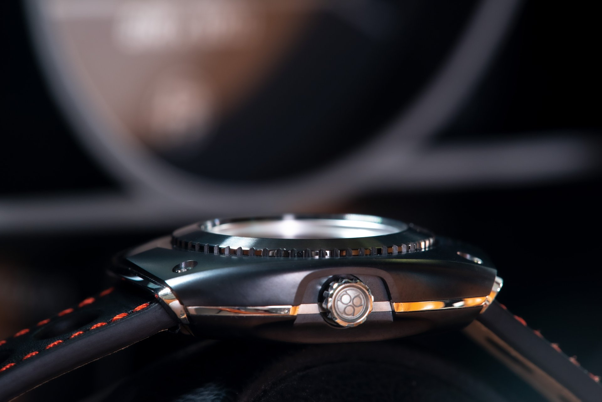 Blasta Watch Scuderia Veloce, silver arrow, side view. Photo taken on the front of a Alfa Romeo Montreal. ©2019 Blasta Watch Ltd. All Rights reserved.