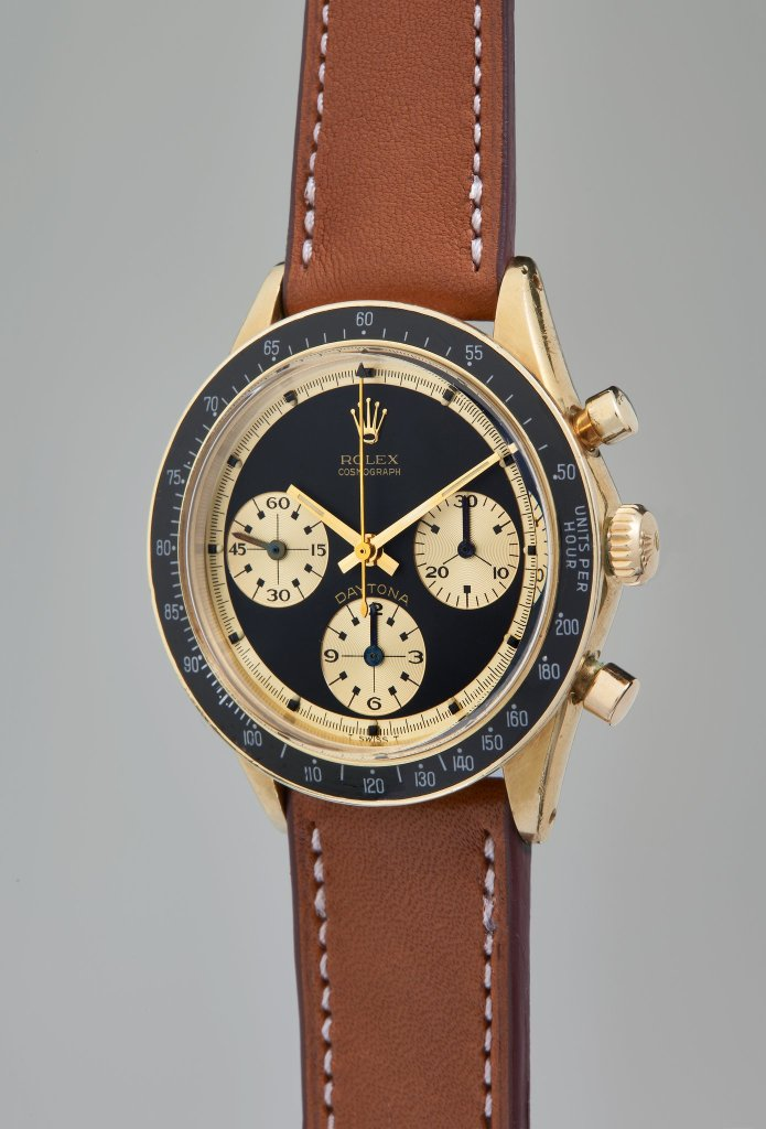 "Rolex, Reference 6241 A very fine, rare and highly attractive yellow gold chronograph wristwatch with ""Paul Newman"" dial and original guarantee, circa 1968"
