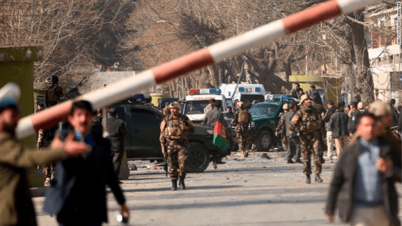 Afghan security forces inspect the site of Saturday's attack in the centre of the Afghan capital. (Courtesy Massoud Hossani/The Associated Press)