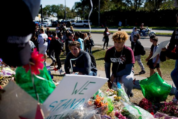 Students walked out of Marjory Stoneman Douglas High School in Parkland, Fla., on Wednesday, one month after 17 people were killed in a shooting at the school. (Courtesy Saul Martinez/The New York Times)