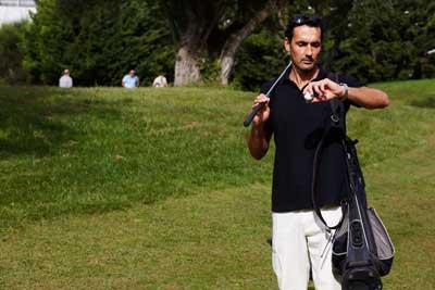golfer checking watch