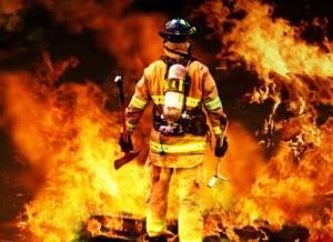 firefighter battling blazing fire
