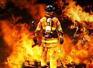 firefighter battling blazing fire