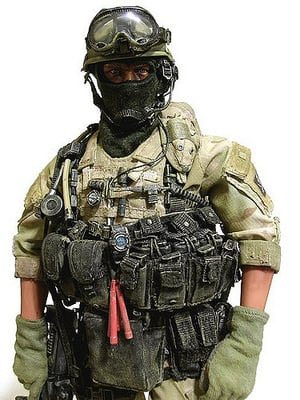navy seal with watch and other gear