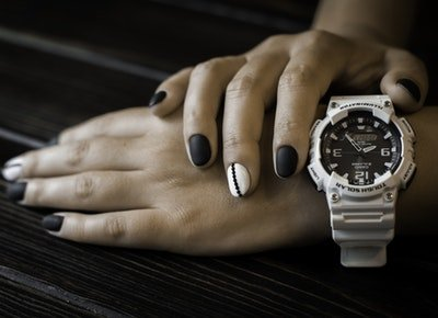 women's watch and hands with painted nails