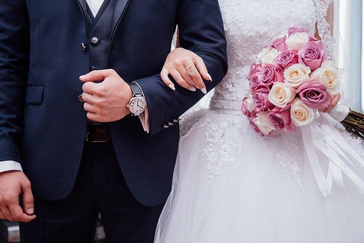 groom wearing watch to wedding